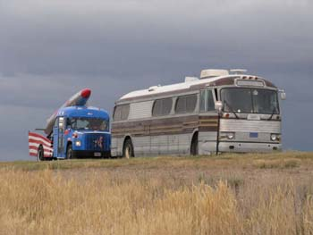 Bus and McCain Vehicle in the Fields